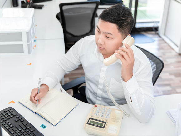 the customer service staff is communicating with the clients via the phone